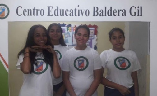 "Freshman Sharline Belliard and peers pose for a ""student memory"" photo at their school in Santiago De Los Caballeros, Dominican Republic. ""I think it's nice to take pictures from school,"" Belliard said. ""When you get older you can see all the memories you had."""