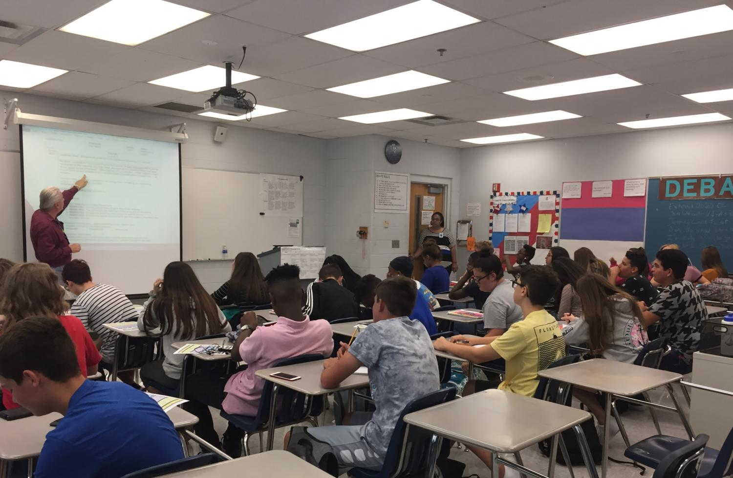 In room 7-221 on Wednesday August 23, debate and speech teacher Dan Smith leads his students on a debate topic. Debate class allows students to broaden their understandings on other opinions.