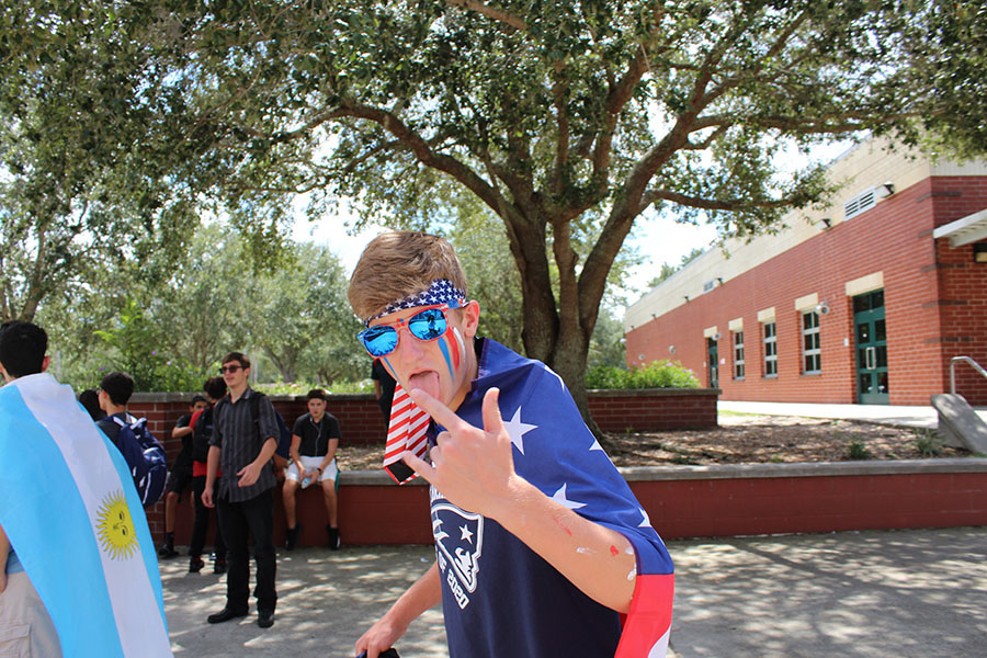 "Sophomore Reese Bennett shows school spirit by being covered in red, white, and blue for freedom friday on september 7. ""Freedom friday and the parade got me excited for the homecoming game and gave me an overwhelming feeling of school spirit, despite how many problems the hurricane was causing for all of us,"" Bennett said. ""I could feel the hype throughout the day."""
