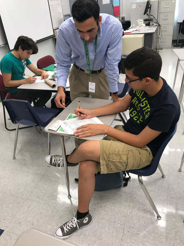 Cheema offers tutoring in his room four days a week after school in order to ensure that his students are truly understanding and excelling in the material that he teaches.  On Tuesday August 22, Mr. Cheema worked diligently after school to help student Zacharia Elshaer with his homework.