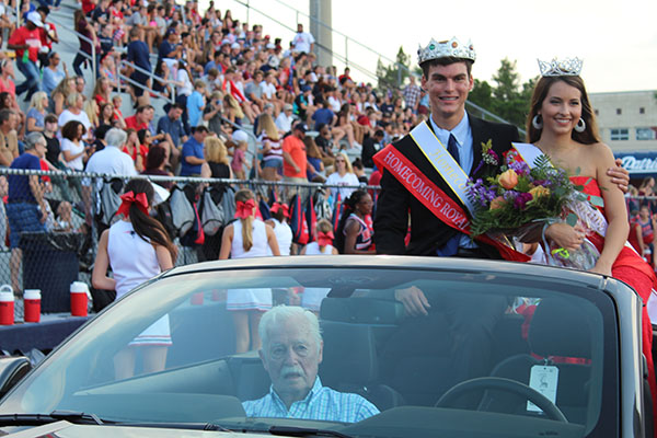 Seniors Matt Little and Jessica Powell prepare for a ride around the Tom Storey Field on Thursday, September 7 after being crowned homecoming King and Queen before the game. Powell and Little were voted winners out of a group of ten by their fellow classmates.