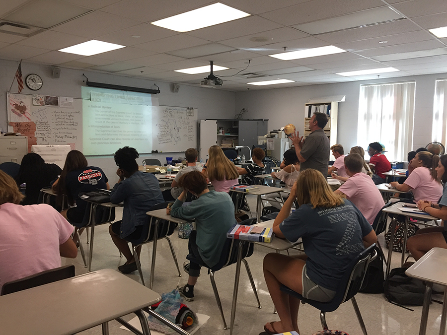 Dr. Bill Geeslin is teaching a lesson to his 5th period Advanced Placement American Government class in room 8-206 on Friday, Oct. 20. Through a PowerPoint, Geeslin taught his students about laws that impacted policy in the Supreme Court.