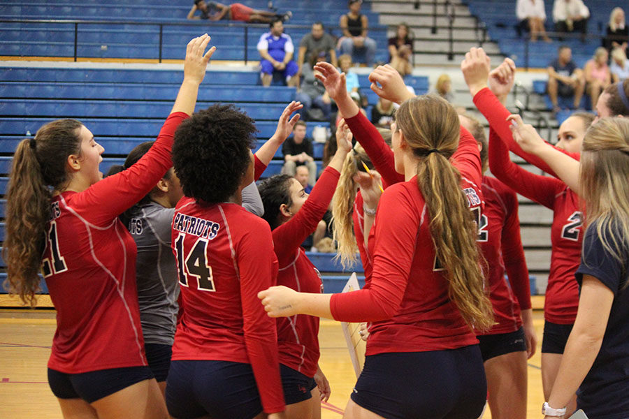 The+varsity+volleyball+team+huddles+together+during+a+water+break+to+discuss+plays+and+motivate+each+other+during+the+Wednesday+Sept.+27+home+game+against+Lyman.+The+team+finished+off+the+game+with+a+win+of++3-2.