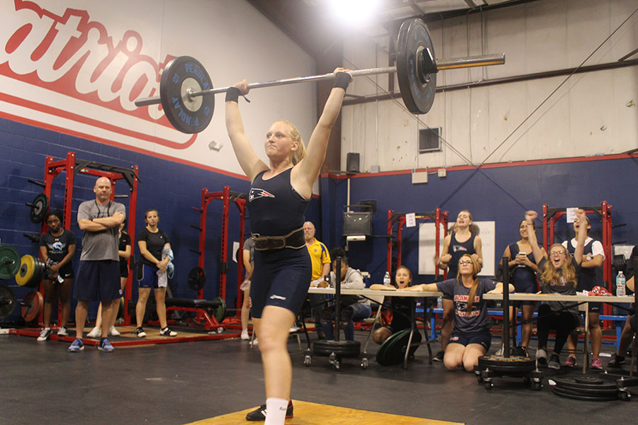 Junior Elena Korkes successfully lifts 135 pounds during the weightlifting meet on Wednesday, Nov. 1. The team cheered her on through one of the heavier lifts that she completed.