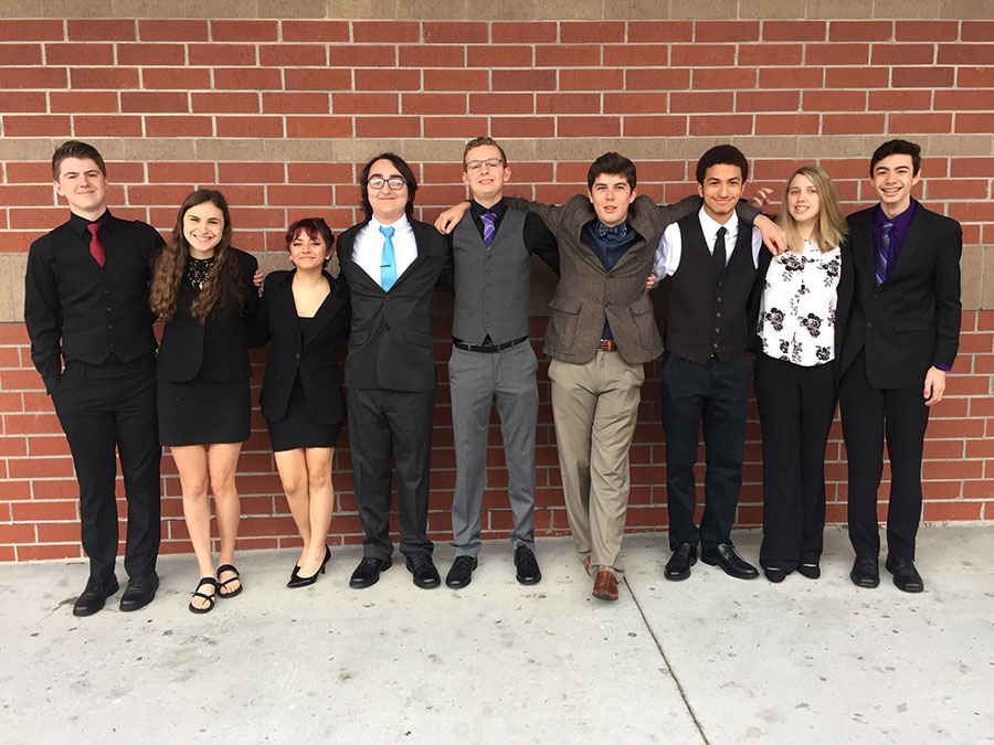The Lake Brantley Debate Team poses together before their first round at their third competition of the season on Saturday, December 9 at Hagerty High School. Senior Grace Staudenmaier placed first in her Original Oratory competition.