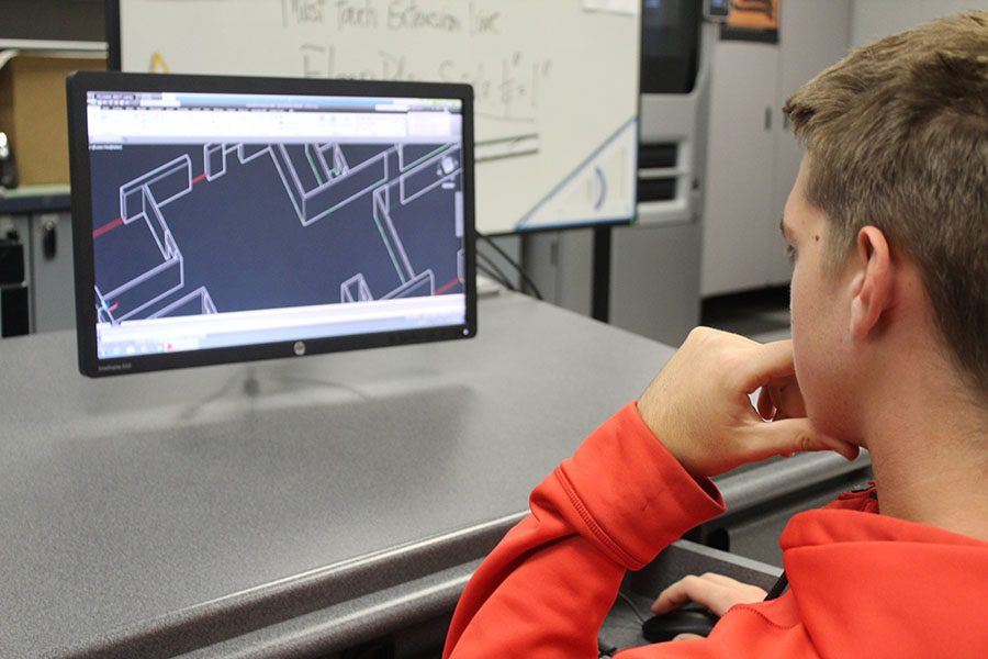 "Junior Brett Feldman inspects his digital blueprint  in his 5th period Drafting Class on January 18. ""I'm designing my floor plan,"" Feldman said. ""I'm making it a 3D model and adding doorways and windows."""