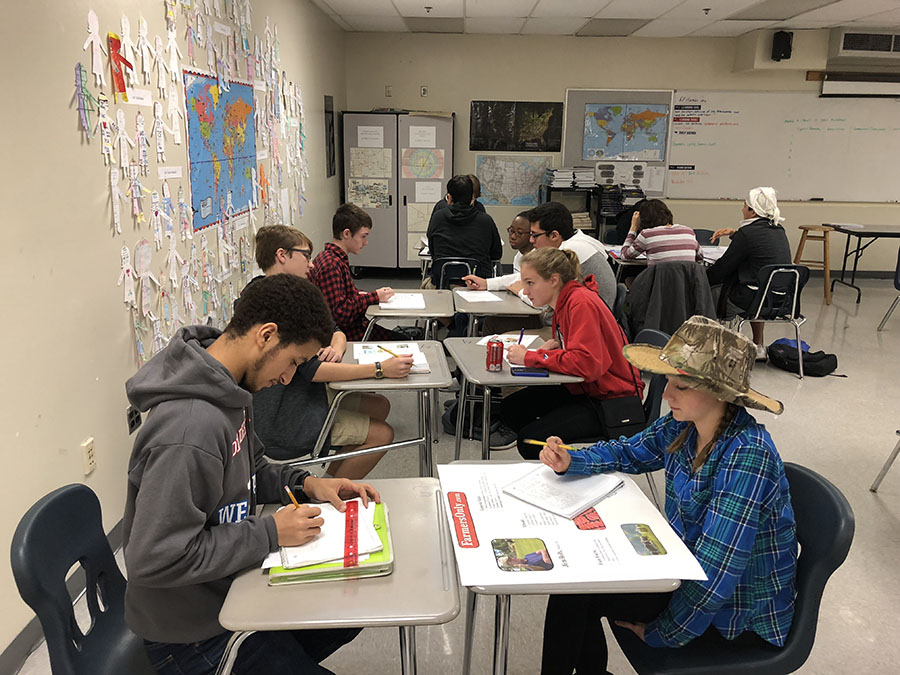 """Students in Carrie Foster's AP Human Geography """"speed date"""" while learning about their classmates' assigned farming type. Each student was given a farming style to research and was expected to come to class with a poster about that farming style."""