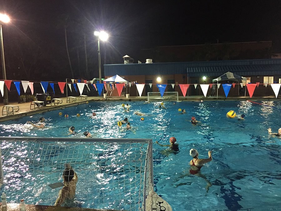 +At+the+James+M.+Sprinkle+Aquatic+Center%2C+the+club+water+polo+team+practices+on+Thursday+night%2C+Jan.+11+Center.+During+the+practice%2C+the+team+members+ran+drills+to+prepare+themselves+for+the+upcoming+tournament+on+Saturday+the+13th+.+%E2%80%9CIt%27s+through+practice+that+we+teach+them+how+to+put+themselves+into+opportunistic+positions+and+then+how+to+capitalize+when+those+opportunities+arise+in+games%2C%E2%80%9D+varsity+water+polo+coach+Matt+Tomlinson+said.