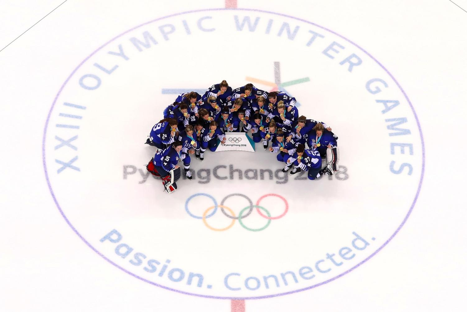 Team United States of America (gold) poses after defeating Team Canada (silver) 3-2 in the Women's Ice Hockey Gold Medal game on day 13 of the PyeongChang 2018 Winter Olympic Games at Kwandong Hockey Centre on February 22, 2018 in Gangneung, Republic of Korea. GettyImages