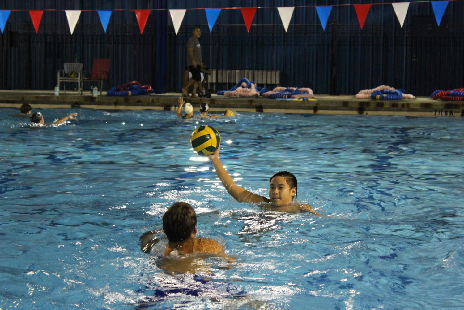 Sophomore+Alexander+Nyugen+is+seen+here+practicing+a+defense+drill.+By+holding+his+hand+up+high+this+drill+emphasizes+both+defense+skills+and+steadiness+for+the+offensive+player.+Due+to+the+fact+that+water+polo+is+a+full+contact+sport+these+drills+often+involve+a+lot+of+pushing+and+splashing.+
