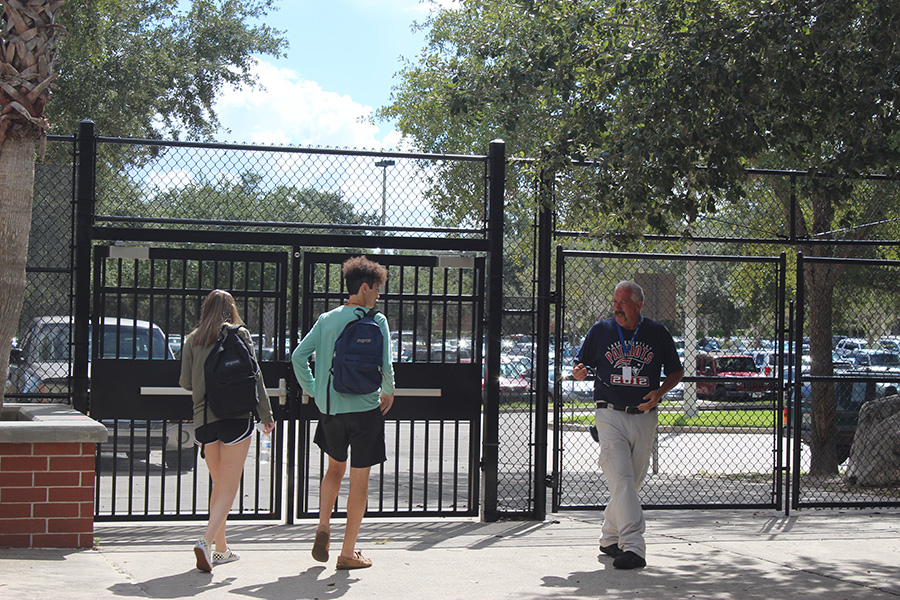 After fourth period, seniors Anthony Nasnas and Katie Keintz leave through the newly installed gate for A lunch.