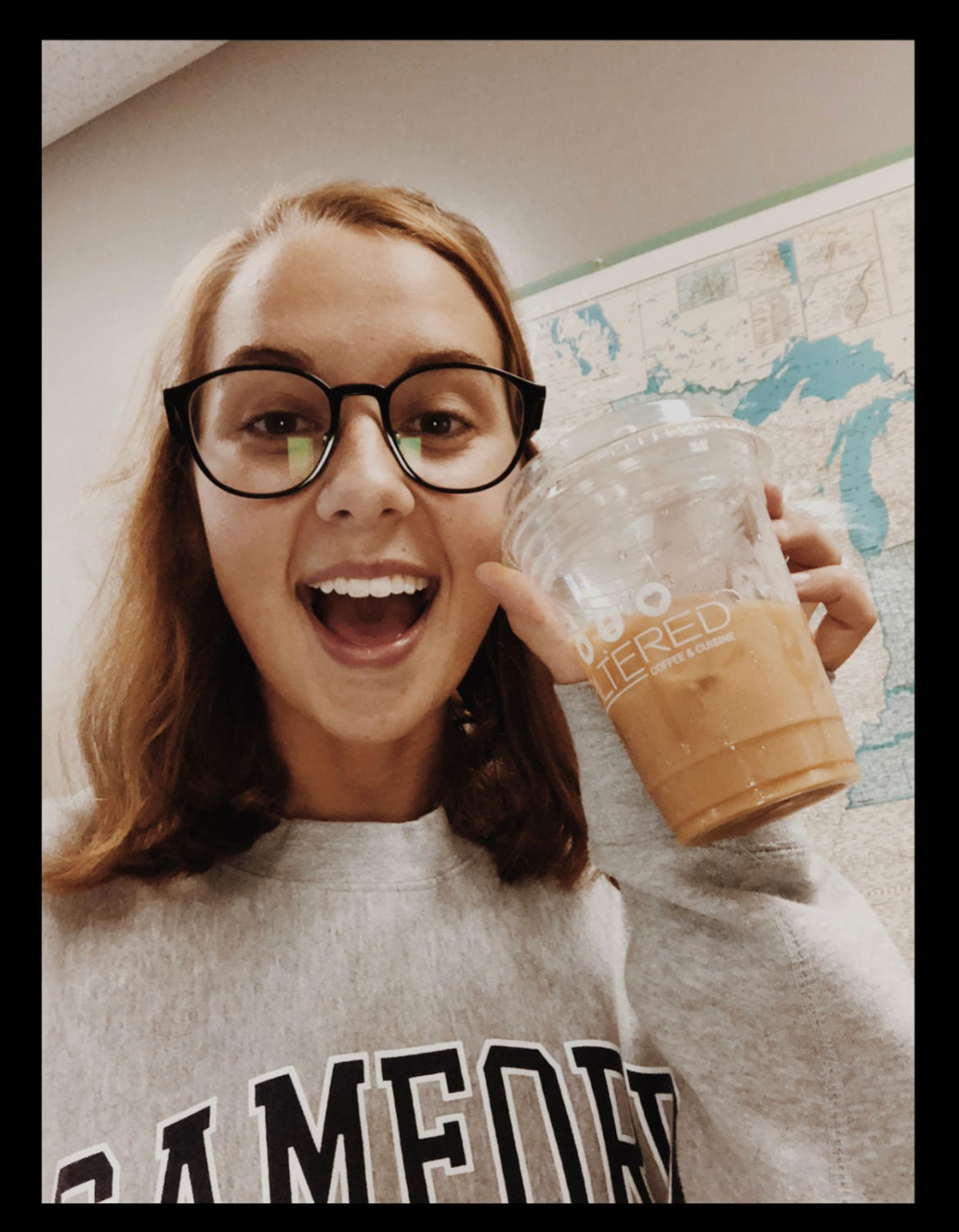 During sixth period, senior Madison Harris poses with her caramel cold brew from FIlterd Coffee and Cuisine.