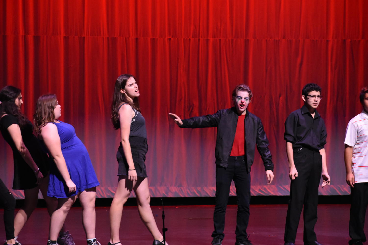 The theater troupe performs their ensemble number