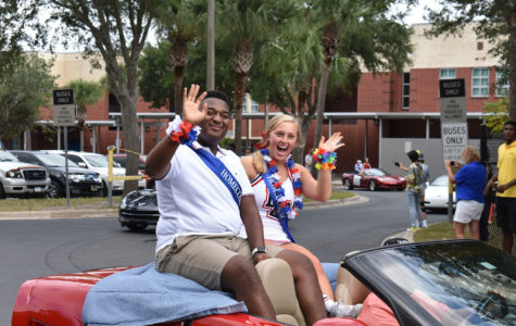 Senior Homecoming Court Trey Langston and Emily Vincent ride in a corvette on Thursday, October 10 in the homecoming parade. There were a total of 11 corvettes in this year's parade.