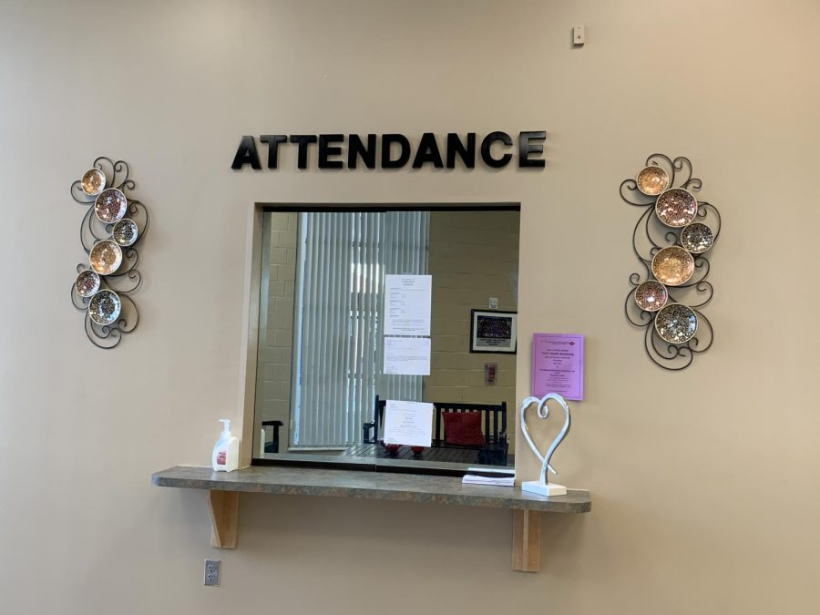 The attendance desk in Building One is where students turn in absence excuse notes to Attendance Secretary Karen Wheatley. Excused absences are included in the absence total until the student reaches 15, after which absences must be excused for a student to avoid losing credit.