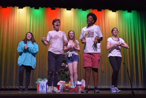 "Leah Sommerio (sophomore), Jacob Shoemate (junior), Alicia Steffy (senior), Avery Lewis (senior), and Kyra Martin (sophomore) rehearse their group number ""Merry Almost Christmas"". ""Everyone kind of had their own acts to work on and they were able to make it their own and perfect it,"" Lewis said. ""It made for a really good show at the end!"""