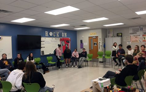 """Students in Peggy Leis's 7th period English Honors class prepare for community circle.  """"It gives me great feedback about what their learning and also what their needs are,"""" Leis said. """"It gives me an idea of how I can reach them better""""."""