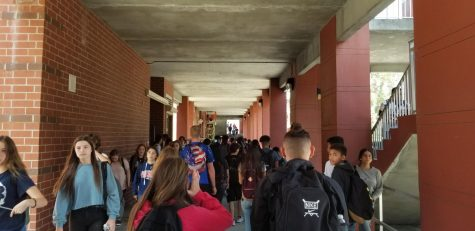 Students travel in between classes through the corridor that accesses the various buildings. Lake Brantley High School has undergone numerous safety procedures to ensure the school is prepared in case of emergency.