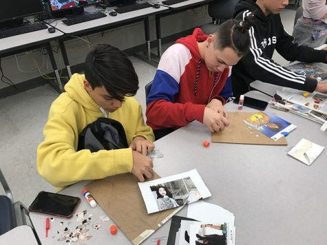"On Feb. 27, students Andres Garcia (left) and Luis Rivera (right), work on gluing their magazine pieces down after sketching out their photo.  ""What I like about this project is how we build the picture bottom to top, piece by piece,"" Garcia said."