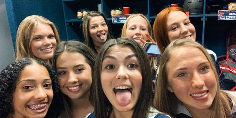 Varsity softball players Ella Christopher, Madison Conway, Valerie Beltre, Payden Bordeau, Katie Lazzopina, Kiley Strott, and Erin Schmutz are preparing for a game against Lake Howell by jamming out to Britney Spears in the locker room on Wednesday, February 19.