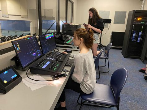 "Sophomores Laura Howell and Ashley Welch play with the sound- and light boards on a set building work day. ""Definitely the people helping me with the lights got me interested,"" Welch said. ""You learn teamwork better- how to work with your peers that you don"