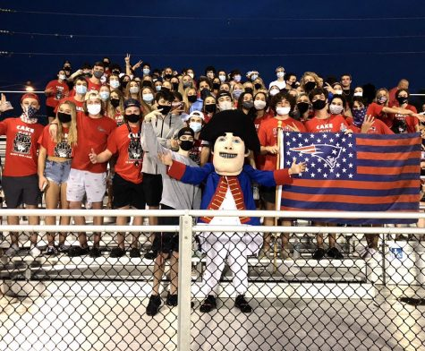 The student section cheers on the varsity football team on Thursday, Sept. 17. Face masks were encouraged in the stands, but social distancing was not enforced. The varsity football team suffered a narrow loss against Lake Mary High School and the final score was 15-14.