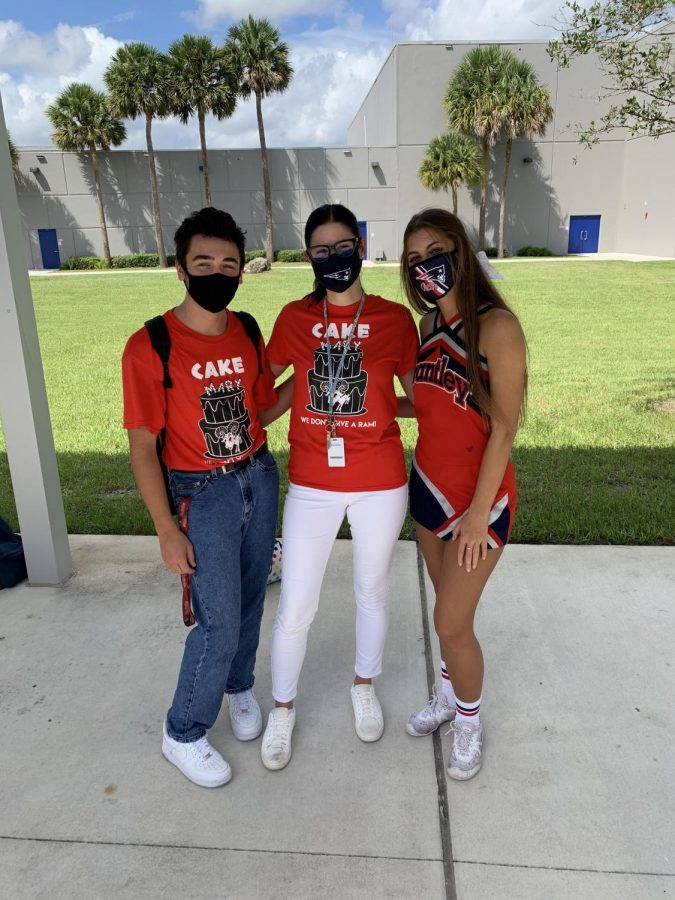 Student Body President and Vice President Ike Schiller and Tess Trimble along with Ms. Audra Greuel showing their school spirit wearing their Beat Lake Mary t-shirts.