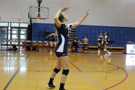Sophomore Mayson Cooney prepares to spike the ball while warming up for the Junior Varsity volleyball game against Seminole High School on Thursday, Sept. 10.