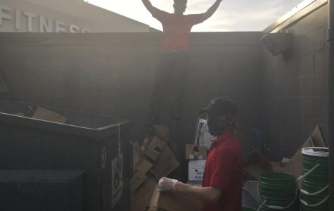 In the midst of the pandemic, these Chick-fil-a employees do their best to maintain social distancing guidelines. They're still able to cooperate as one can break down the boxes while the other organizes them into the dumpster. These are just some of the ways they try to stay safe during the pandemic.