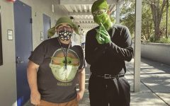 Chorus teacher Nicholas Powers and drama teacher Chase Cashion show school spirit by dressing up for