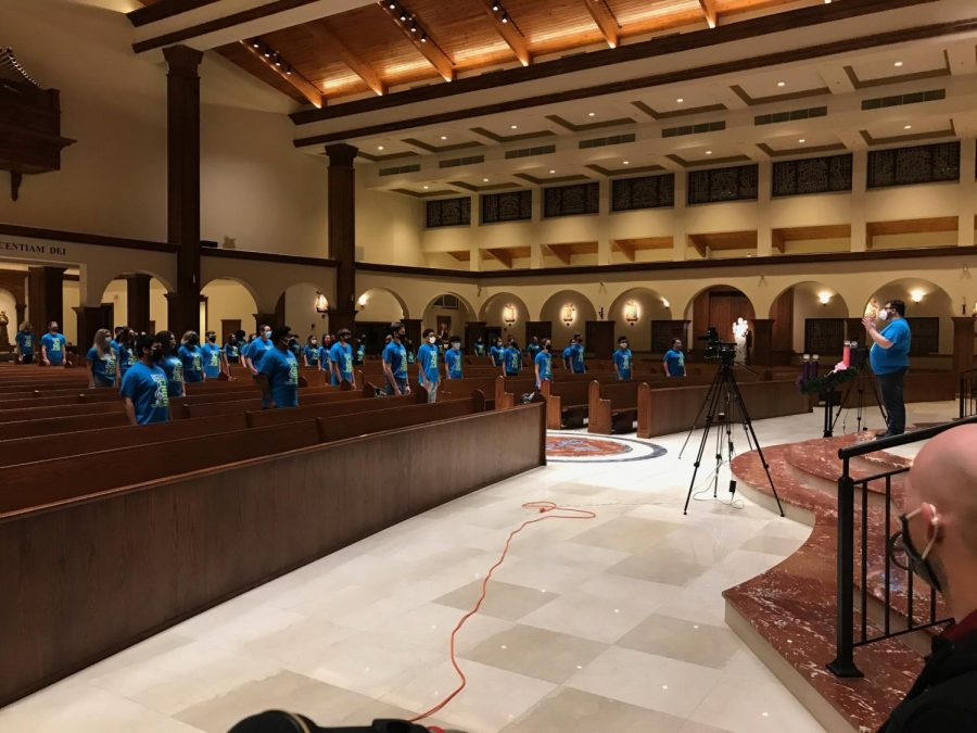 While socially distancing, chorus prepares for their first virtual concert at the Annunciation Catholic Church. Due to the COVID-19  pandemic students were distanced, masked, and could only sing for 30 minutes at a time.