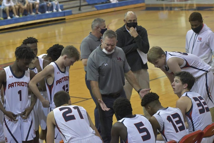 "On Dec. 4 during the varsity boys basketball game against the Oviedo High School Lions, varsity coach Mike Cuff motivates and instructs players on what to do during the game. ""I think the boys have really bonded and have come together,"" Cuff said. ""The coaches challenged them and they have responded."""