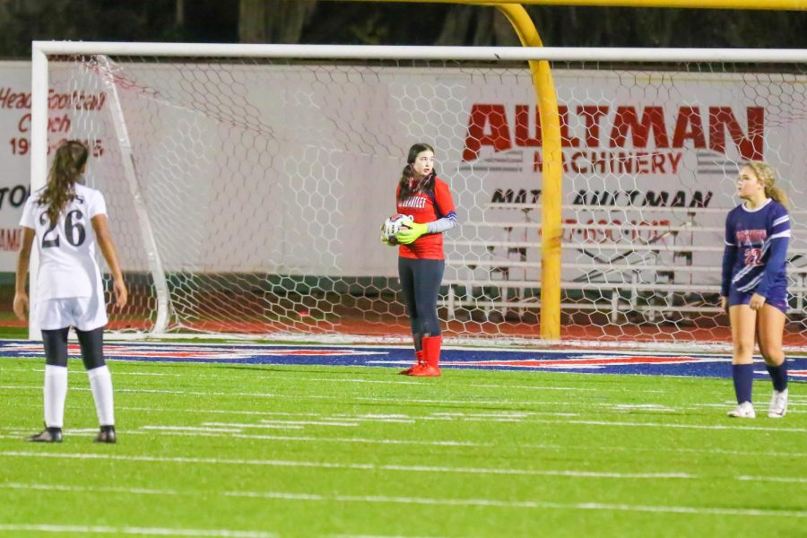 Junior Lindsey Follesse serves as goalie during a JV soccer game. Follesse has a neurological condition called Narcolepsy.