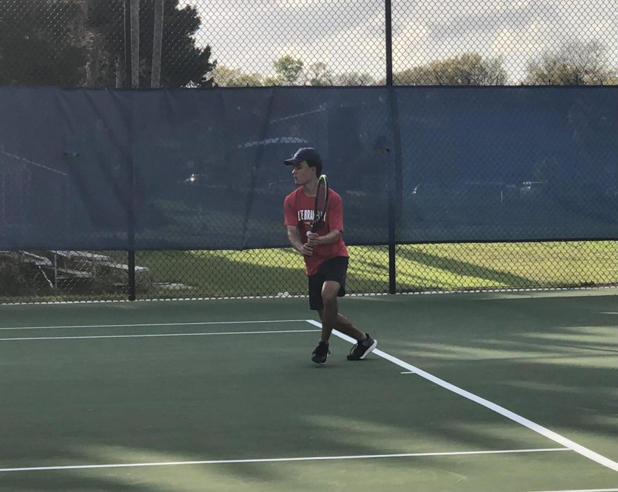 """Sophomore Dean Scornik plays singles against Apopka High School. """"My favorite part of tennis is the mental aspect and its individuality,"""" Scornik said. """"Tennis is a sport where you often have to rely on yourself and your mental strength in order to win tough matches."""""""