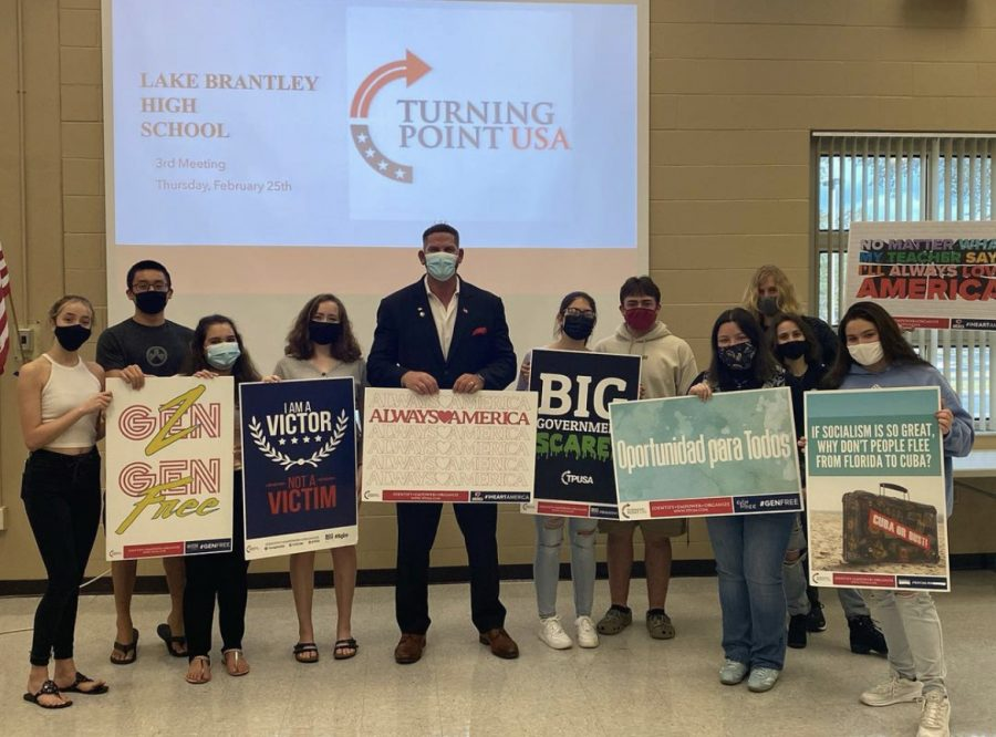 Members of the Turning Point United States of America (TPUSA) club stand with guest speaker Matt Morgan on Feb. 19.