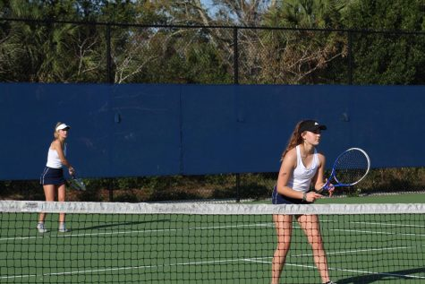 """Unlike years prior, the ability for tennis players to receive instruction and practice before the start of the tennis season was lessened because of the onslaught of restrictions regarding COVID-19. Sophomore Delaney Taylor on the girls' varsity tennis team has felt the effects firsthand, but found a way to improve and compete with the competition. """"Last week we won both of our doubles and singles games,"""" Taylor said. I believe the doubles score was eight to one and the singles score was eight to two."""""""