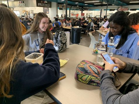 """On Apr. 22, sophomores Chloe Graham, Emma Pullin, Mayson Cooney, and Delaney Taylor enjoy their food during C lunch. The girls decided to sit indoors to eat their meals. """"I like sitting inside because there's no bees inside,"""" sophomore Chloe Graham said. """"All the bees from outside used to eat my food, but now none of the bees eat my food."""""""