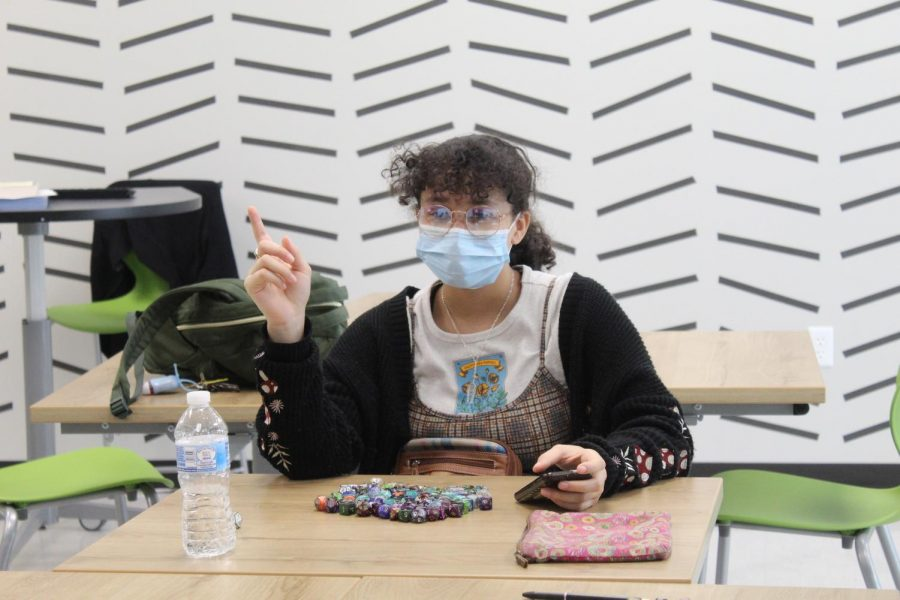 """Kiera Moore sits in front of her collection of dice as she participates in an adventure at Friday, Sep. 2's Dungeons & Dragons club meeting. """"I've been playing D&D for about 4 years,"""" Moore said. """"A friend of mine invited me to play because I bought her a D&D starter kit from Barnes and Noble."""""""