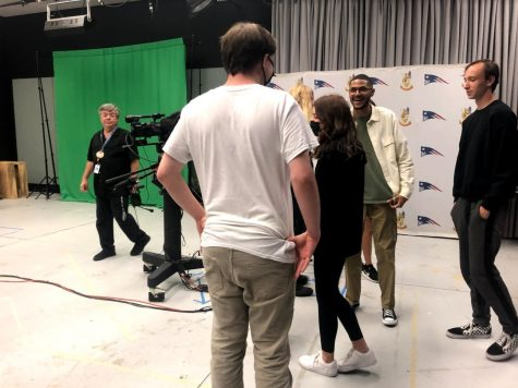 """Members of Cinema Club converse in the TV Production room, where they will be working on their club film during meetings. """"I feel like I'm gaining knowledge about the making of films and making new friends,"""" sophomore Hannah Waller said."""