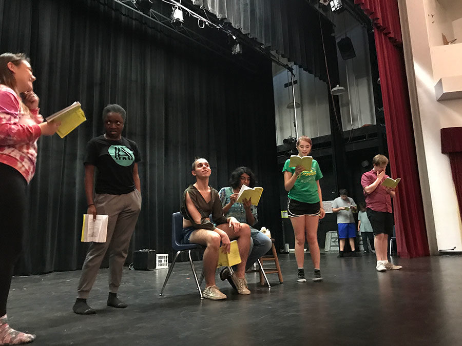 """On Thursday, Sept. 28, the cast of Noises Off rehearses the first act in the Cynthia Berry Auditorium, overseen by drama teacher and director Laura Molloy. The cast learned how to deliver their lines and portray their characters. """"Acting is not just reading lines, it's making your character come to life,"""" junior Abiola Adebanjo said."""