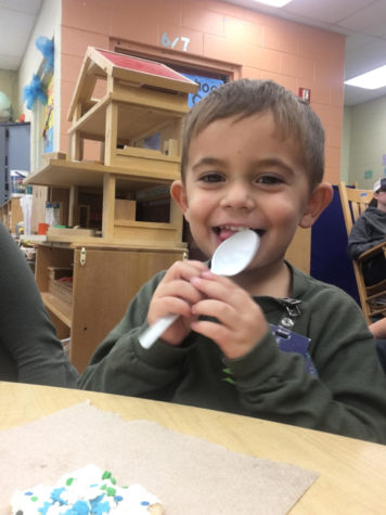 Three-year-old Carter Perales enjoys himself after the yearly December Gingerbread Hunt lead by the Early Childhood class. Before the students could join the cookie decorating, they first had to find their gingerbread that had been hidden by instructor Andrea Lesko.