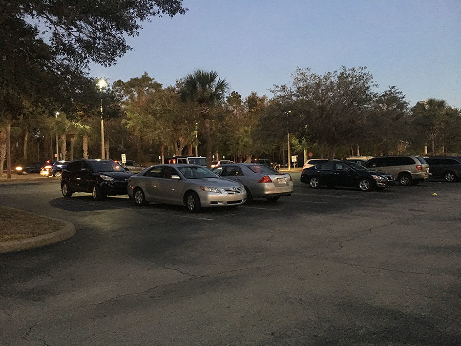 In order to avoid the crowds of cars in the student parking lot, some students park in the teacher parking lot. These students would rather risk getting caught and towed than wait behind hordes of cars in the student parking lot.
