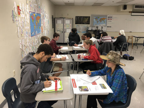 "Students in Carrie Foster's AP Human Geography ""speed date"" while learning about their classmates' assigned farming type. Each student was given a farming style to research and was expected to come to class with a poster about that farming style."