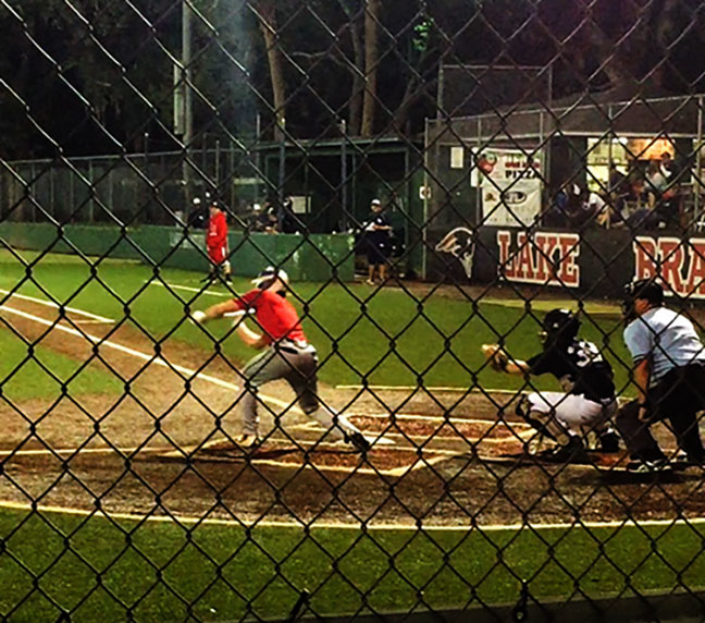 """On Nov. 16 freshman Caleb Elferink stepped up for bat when playing for Lake Brantley against Lake Howell during the fall season. The photo was taken by Caleb's mother, Shannon Elferink at Lake Brantley's baseball field during the third inning of the game. """"I was really excited for this game because I was finally playing for Brantley which I was looking forward to for most of summer, """"Freshman Caleb Elferink said. """"Even though it wasn't the official baseball season the fall season was important part to the beginning of my high school career."""""""