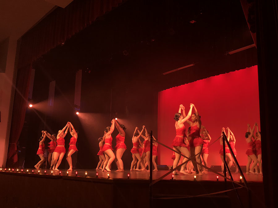 """JV and Varsity Sparklers dance to """"SMB"""" during the Spring Dance Show on May 10. This dance was unlike the others because it was salsa themed."""