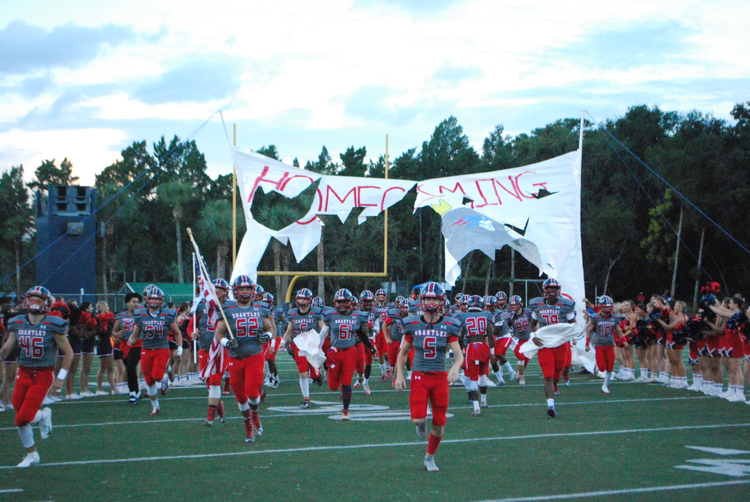 On Friday, September 21st, the varsity football team charges through the banner to start the game. The Patriots won the game, with a final score of  35-28
