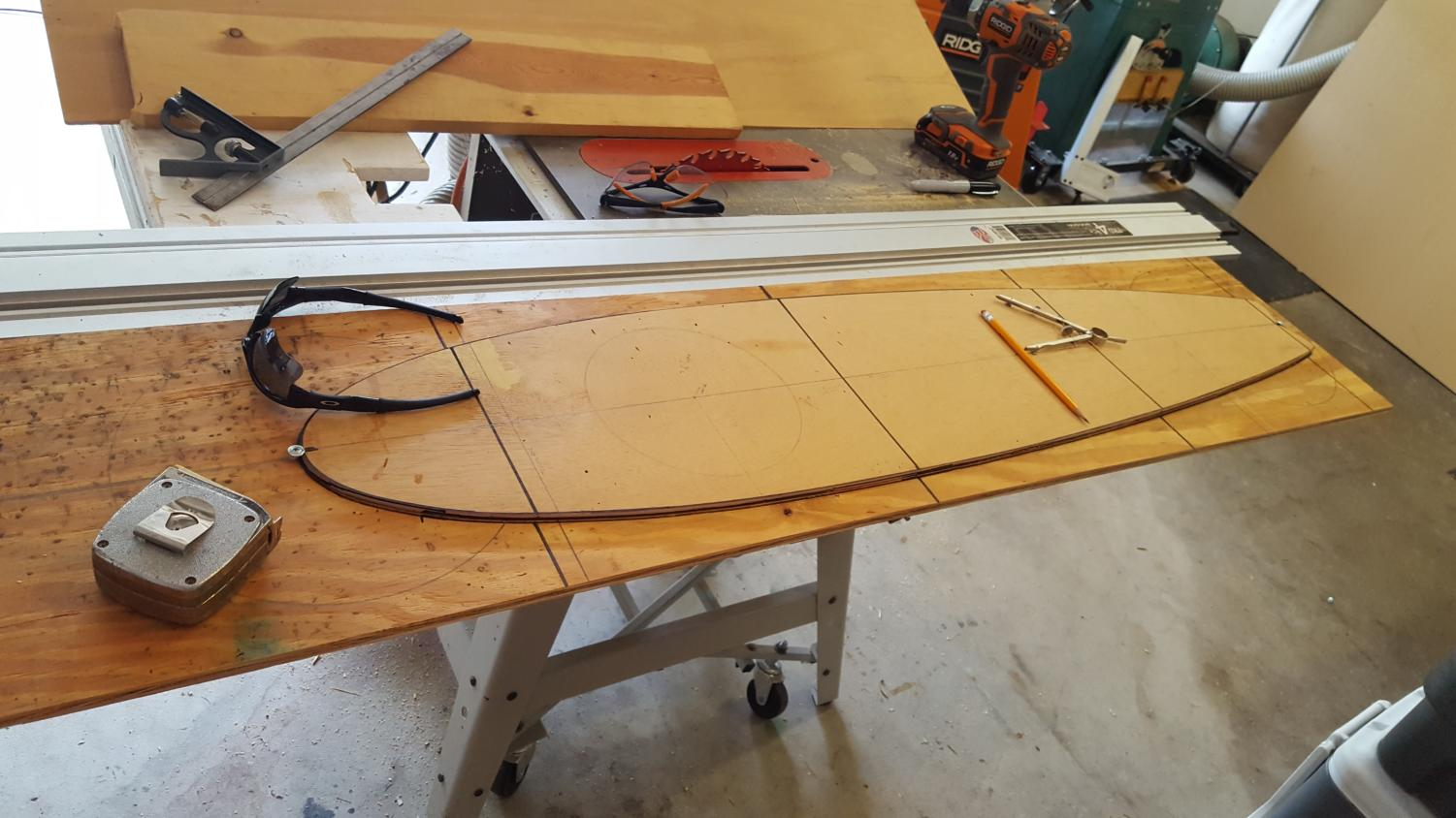 A plank of wood sits on a work bench in freshman Thomas Morris's garage,