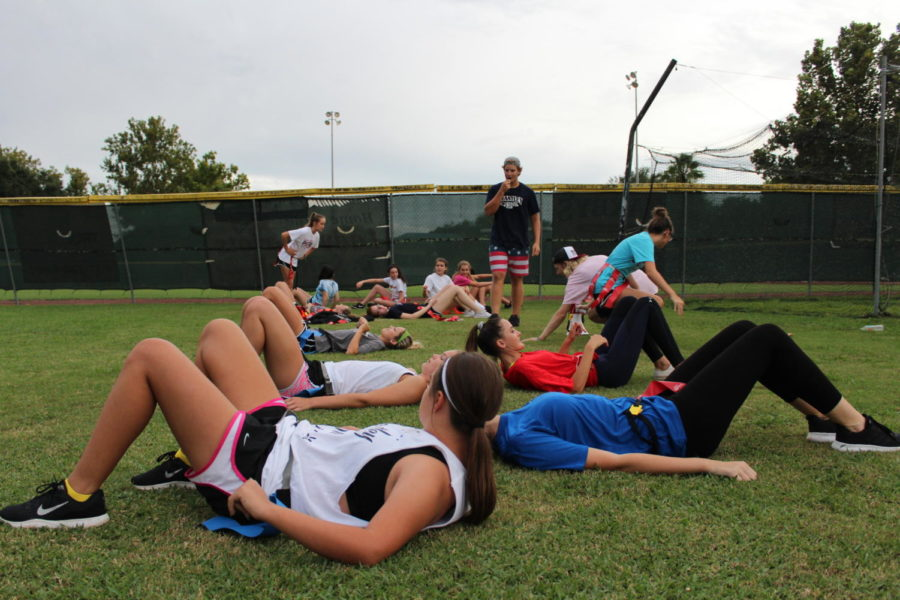 The junior girl powder puff participants await instructions for the skill they are learning on Monday, August 27. The girls were coached by juniors on Brantley's varsity football team.