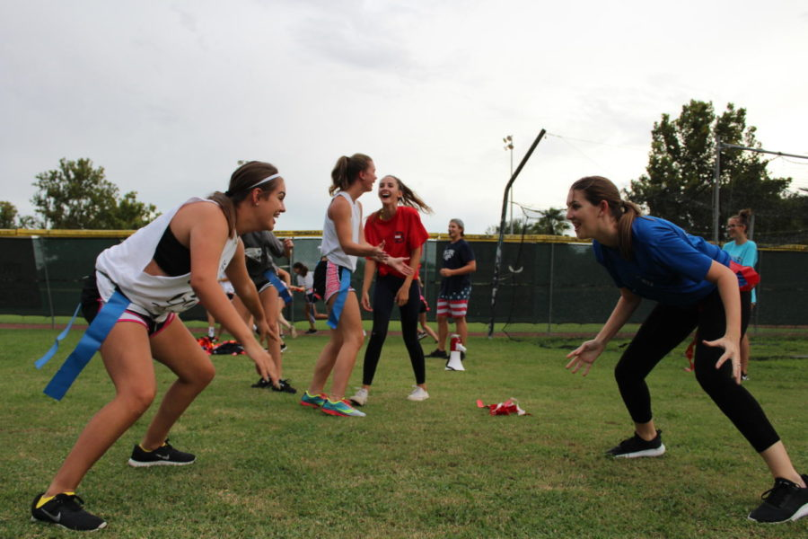 Junior girls attempt to pull each others flag belts at practice on Monday, August 27. The powder puff game on Monday, September 17 was a flag football game between the juniors and seniors.