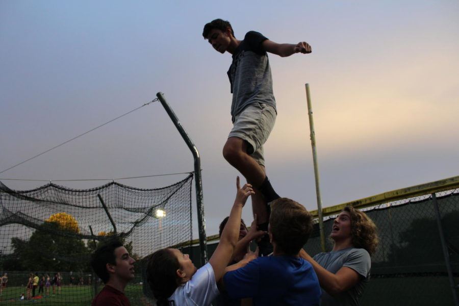 """Junior Cameron Johnston tries a liberty (a stunt using only one leg) at practice on Monday, August 27. """"My favorite part about being in powderpuff was definitely being able to hang out with everyone from my class,"""" Johnston said. """"They made everything seem like fun and not work, which made both practice and the game extremely fun to do."""""""